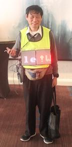 man wearing digital sign